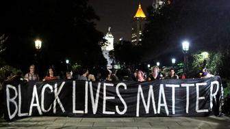 People hold up a banner during a Black Lives Matter protest outside City Hall in Manhattan, New York, U.S., August 1, 2016.  REUTERS/Andrew Kelly