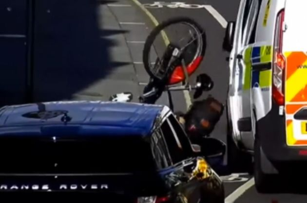 Jake Nedd is seen being thrown off his bike after being nudged by Inspector Richard