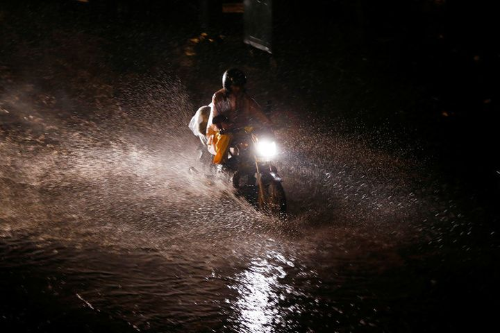 A waterlogged street in Delhi. How can a city with so much rain face water shortages?