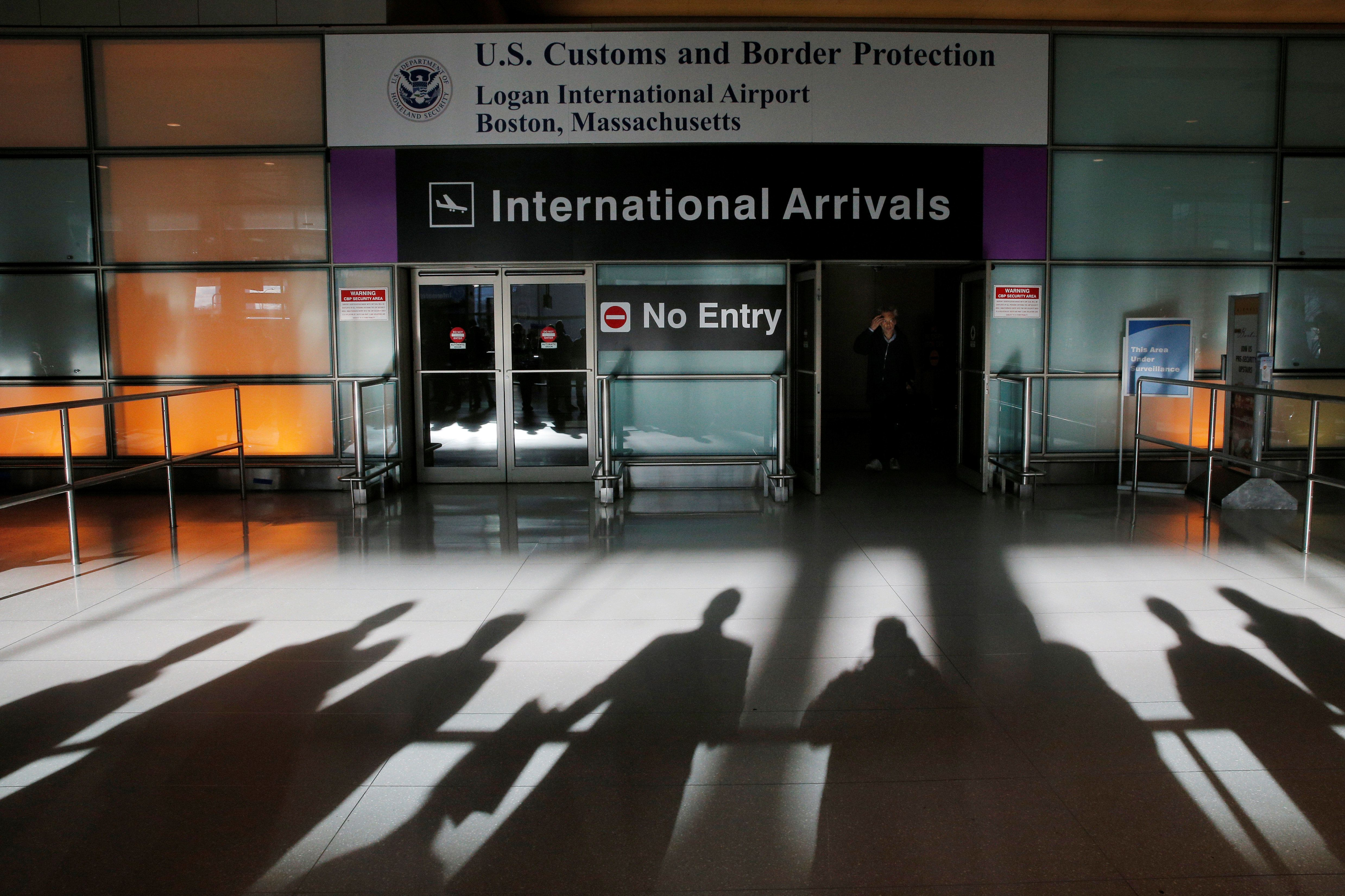 An international traveler arrives after U.S. President Donald Trump's executive order travel ban at Logan Airport in Boston, Massachusetts, U.S. January 30, 2017.   REUTERS/Brian Snyder