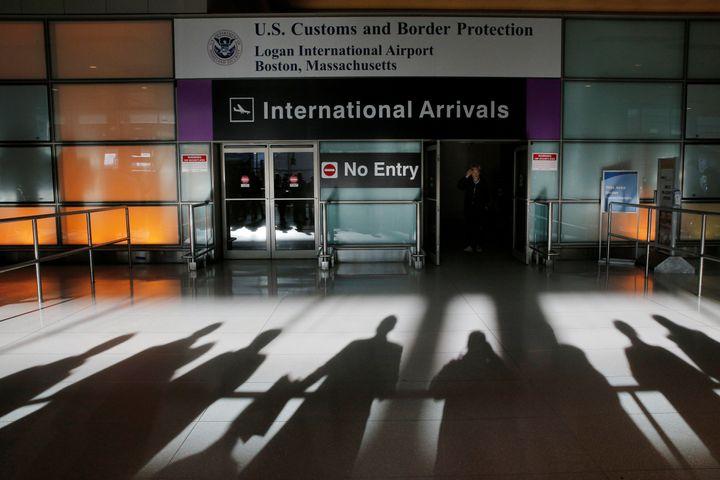An international traveler arrives at Logan Airport in Boston, Massachusetts.