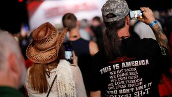 Supporters listen to U.S. President Donald Trump deliver remarks at the National Rifle Association (NRA) Leadership Forum at the Georgia World Congress Center in Atlanta, Georgia, U.S., April 28, 2017. REUTERS/Jonathan Ernst