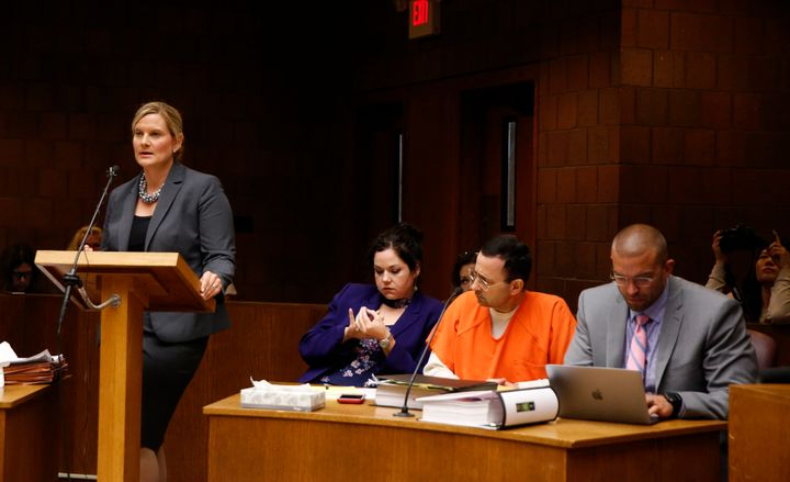 Asst. Michigan Attorney General Angela M. Povilaitis (L) speaks during a June 23 hearing of Larry Nassar. Defense attorn