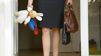 Working mother with briefcase