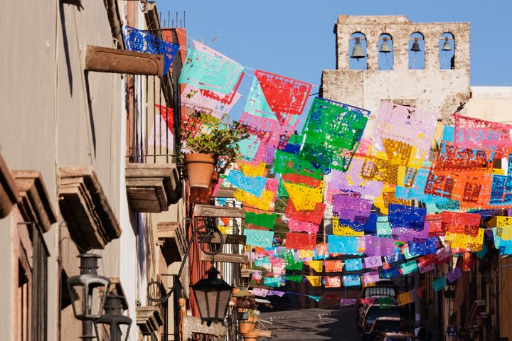 Colorful flags decorate the streets in San Miguel.