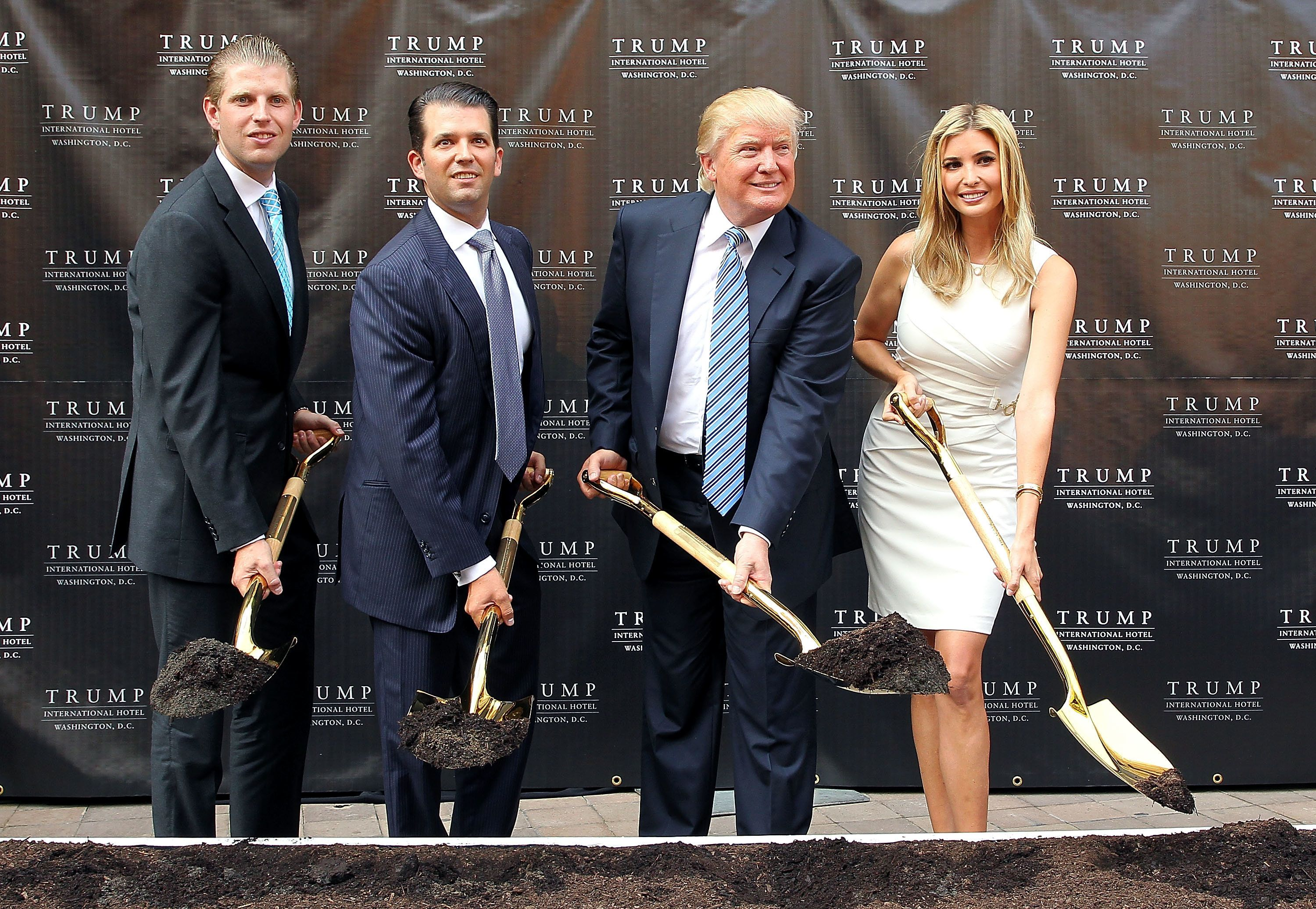 WASHINGTON, DC - JULY 23:  Trump family members (L to R) Eric Trump, Donald Trump Jr., Donald  Trump and Ivanka Trump break ground at the Trump International Hotel Washington, D.C Groundbreaking Ceremony at Old Post Office on July 23, 2014 in Washington, DC.  (Photo by Paul Morigi/WireImage)