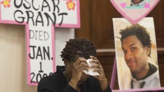 Tressa Sherrod cries after telling the story of her son, 22-year-old John Crawford III who was shot and killed by police in an Ohio Walmart, during a press conference with other mothers who have lost children due to police action as they call for police accountability and reform on Capitol Hill in Washington, DC, December 10, 2014. Representatives from Mothers Against Police Brutality, Codepink, National Congress of Black Women and the Hands Up DC Coalition brought together 10 mothers who have had children killed to lobby Congress for police reform and accountability. AFP PHOTO / SAUL LOEB        (Photo credit should read SAUL LOEB/AFP/Getty Images)