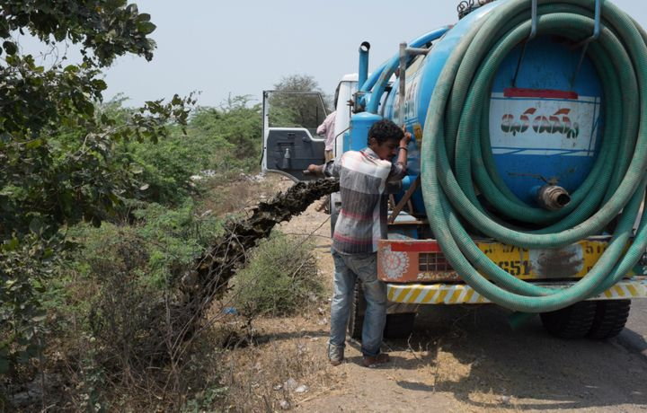 "A photo taken in India by student researcher Sharada Prasad shows a truck dumping human feces on the side of the road. ""Thus"