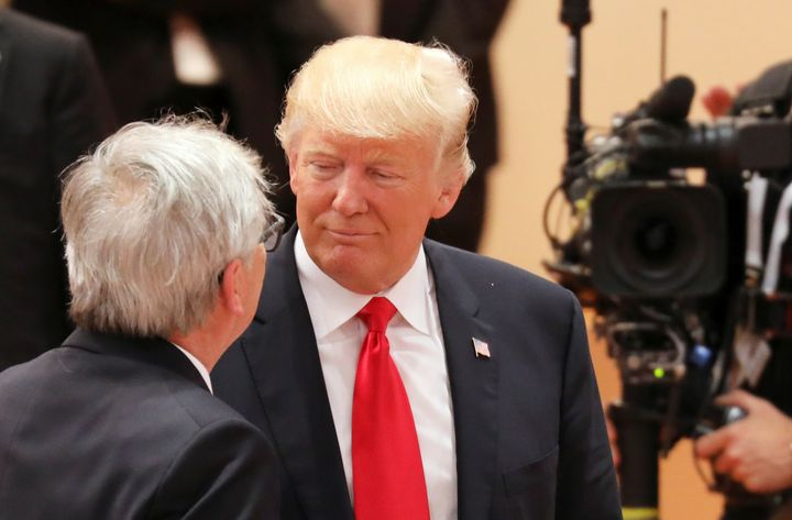 President Donald Trump talks to European Commission President Jean-Claude Juncker at the G20 meeting in Germany on July 8.