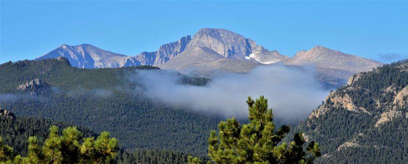 Longs Peak rises above the clouds near Estes Park, Colorado
