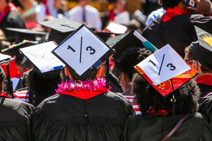 Stanford students wear a 1/3 sign on their caps to show solidarity for a Stanford rape victim during graduation ceremonies at Stanford University on June 12, 2016. The 1/3 stands for the statistic that 1 in three students will experience sexual assault by the time they graduate.
