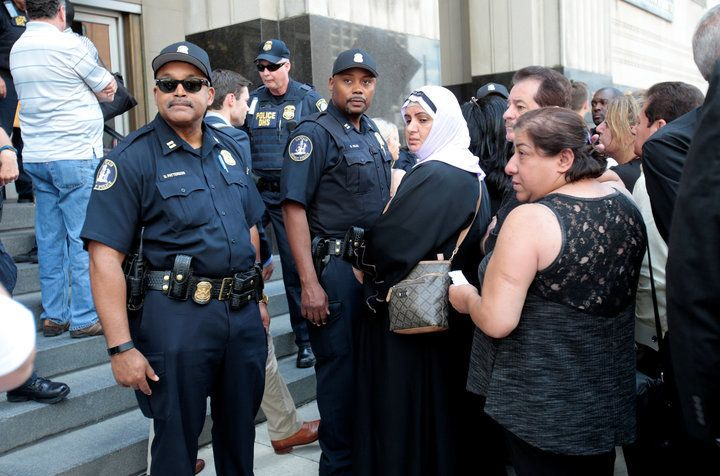 Family members of detainees line up to enter the federal court just before a hearing to consider a class-action lawsuit filed
