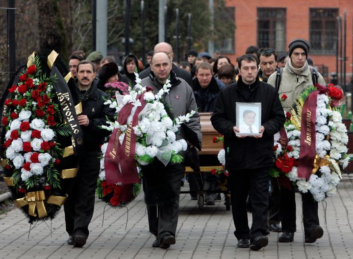 Friends and relatives take part in the funeral ceremony for Sergei Magnitsky in Moscow on Nov. 20, 2009. Magnitsky died