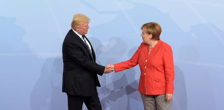 U.S. President Donald Trump is welcomed by German Chancellor Angela Merkel on the first day of the G-20 summit.