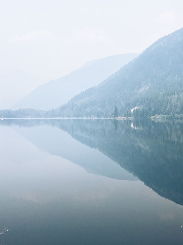 A reflection through the smog at Three Valley Lake, resulting from >200 forest fires across British Columbia