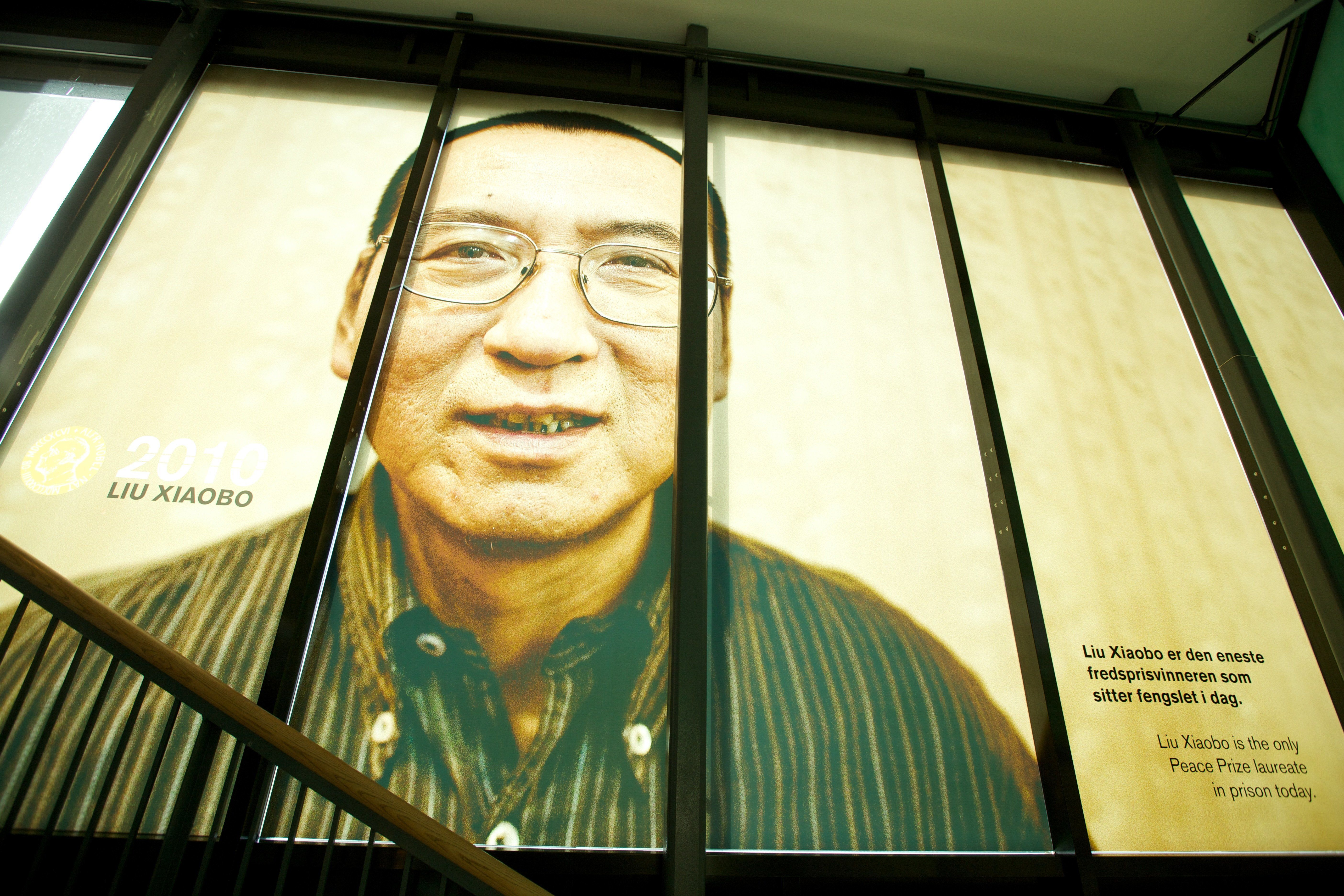 OSLO, NORWAY - OCTOBER 11: . A picture of the 2010 Nobel Peace Prize Laureate Liu Xiaobo is seen at The exhibition ?Be Democracy? at The Nobel Peace Center on October 11, 2014 in Oslo, Norway. (Photo by Ragnar Singsaas/Getty Images)