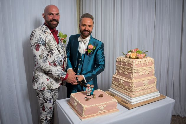 The wedding cake featured miniature versions of the happy couple - complete with replica wedding suits...