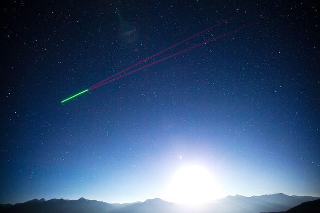 Quantum satellite 'Micius' flies past the quantum teleportation experiment platform in Ali, southwest...