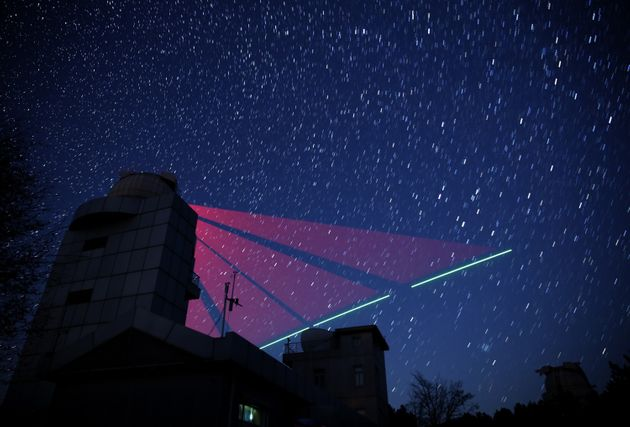 Composite photo shows a satellite-to-earth link established between quantum satellite 'Micius' and the...
