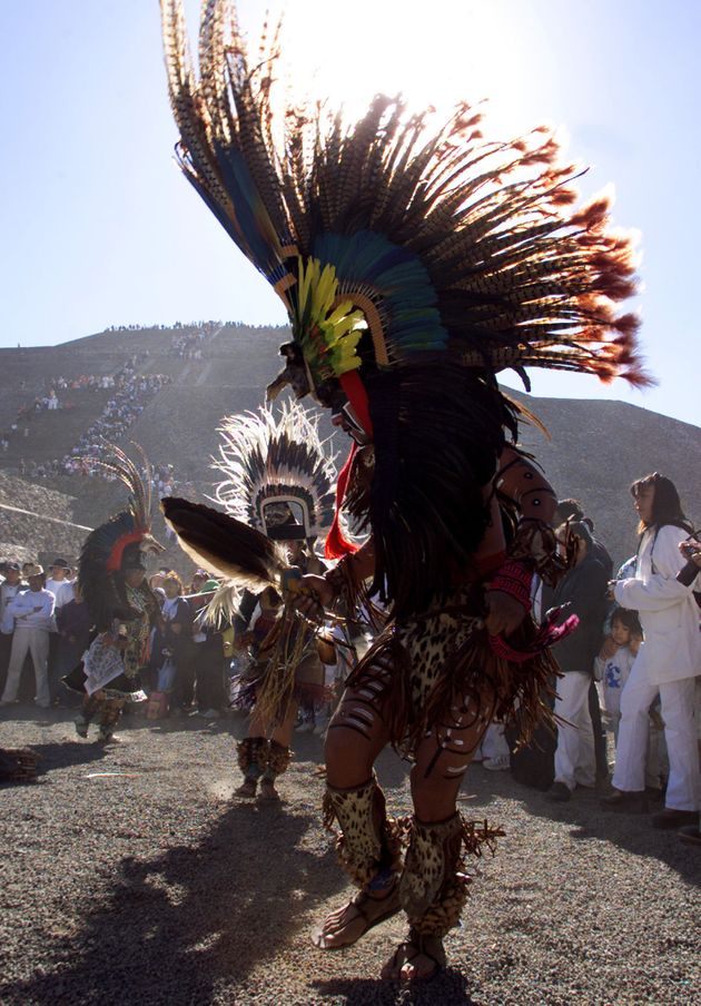A traditional Mexican dancer performs in front of the pyramid in 2001. Hundreds of people meetin...