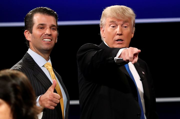 "Donald Trump Jr., left, has the support of his father in what the president calls a ""witch hunt."""