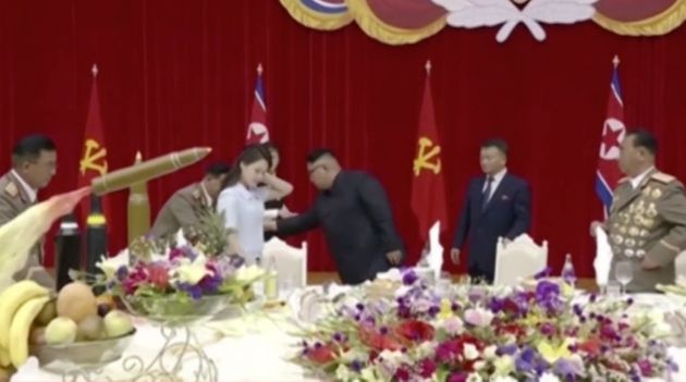 Kim Jong Un (centre) and his wife Ri Sol Ju (left) attended a banquet to celebrate the successful launch...