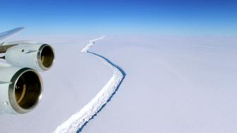 FILE PHOTO: A rift across the Larsen C Ice Shelf that had grown longer and deeper is seen during an airborne surveys of changes in polar ice over the Antarctic Peninsula from NASA's DC-8 research aircraft on November 10, 2016.   Coutesy NASA/Handout via REUTERS/File Photo     ATTENTION EDITORS - THIS IMAGE WAS PROVIDED BY A THIRD PARTY. EDITORIAL USE ONLY