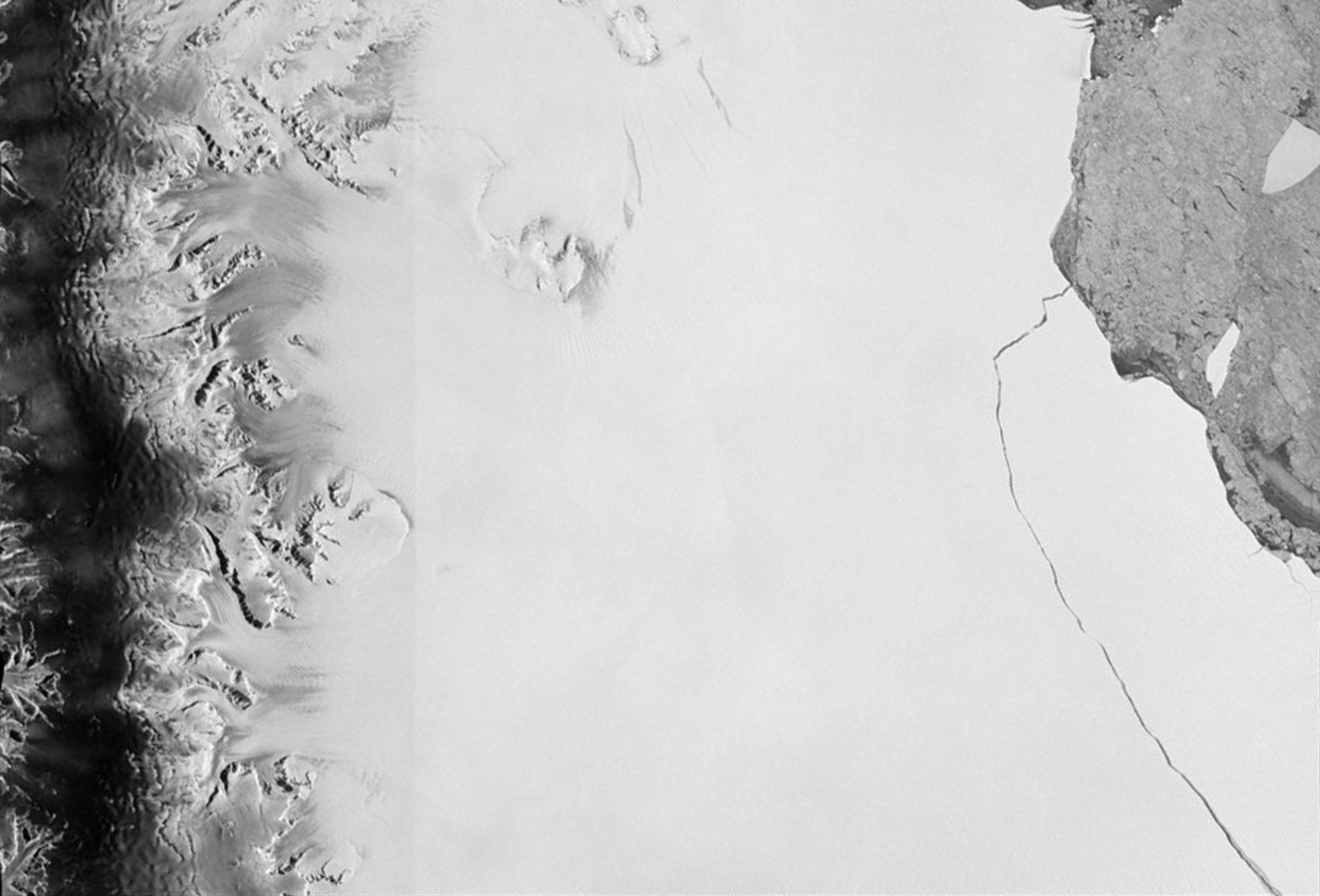 Scientists capture iceberg breaking away from a glacier in Greenland