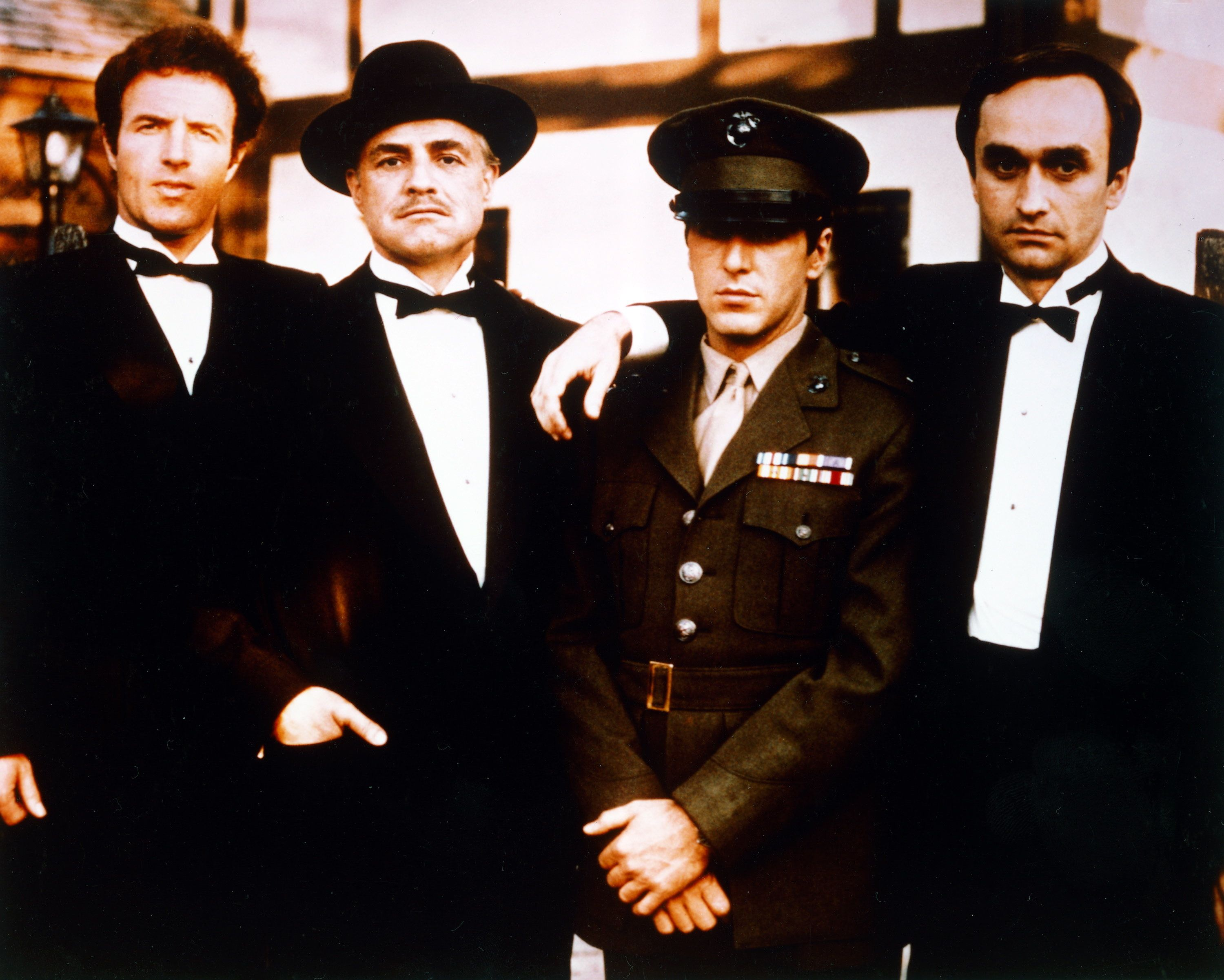 From left: James Caan, US actor, Marlon Brando (1924–2004), US actor, Al Pacino, US actor, and John Cazale (1935-1978), US actor, all in black suits, shite shirts and black bow ties except for Pacino who wears a military uniform, pose for a group portrait issued as publicity for the film, 'The Godfather', 1972. The mafia drama, directed by Francis Ford Coppola, starred Caan as 'Santino 'Sonny' Corleone', Brando as 'Don Vito Corleone', Pacino as 'Michael Corleone', and Cazale as 'Fredo Corleone'. (Photo by Silver Screen Collection/Getty Images)