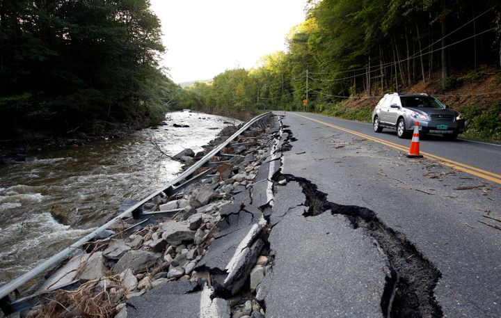 A car passes a section of Route 112 that was washed out during Hurricane Irene in Halifax, Vermont August 29, 2011.