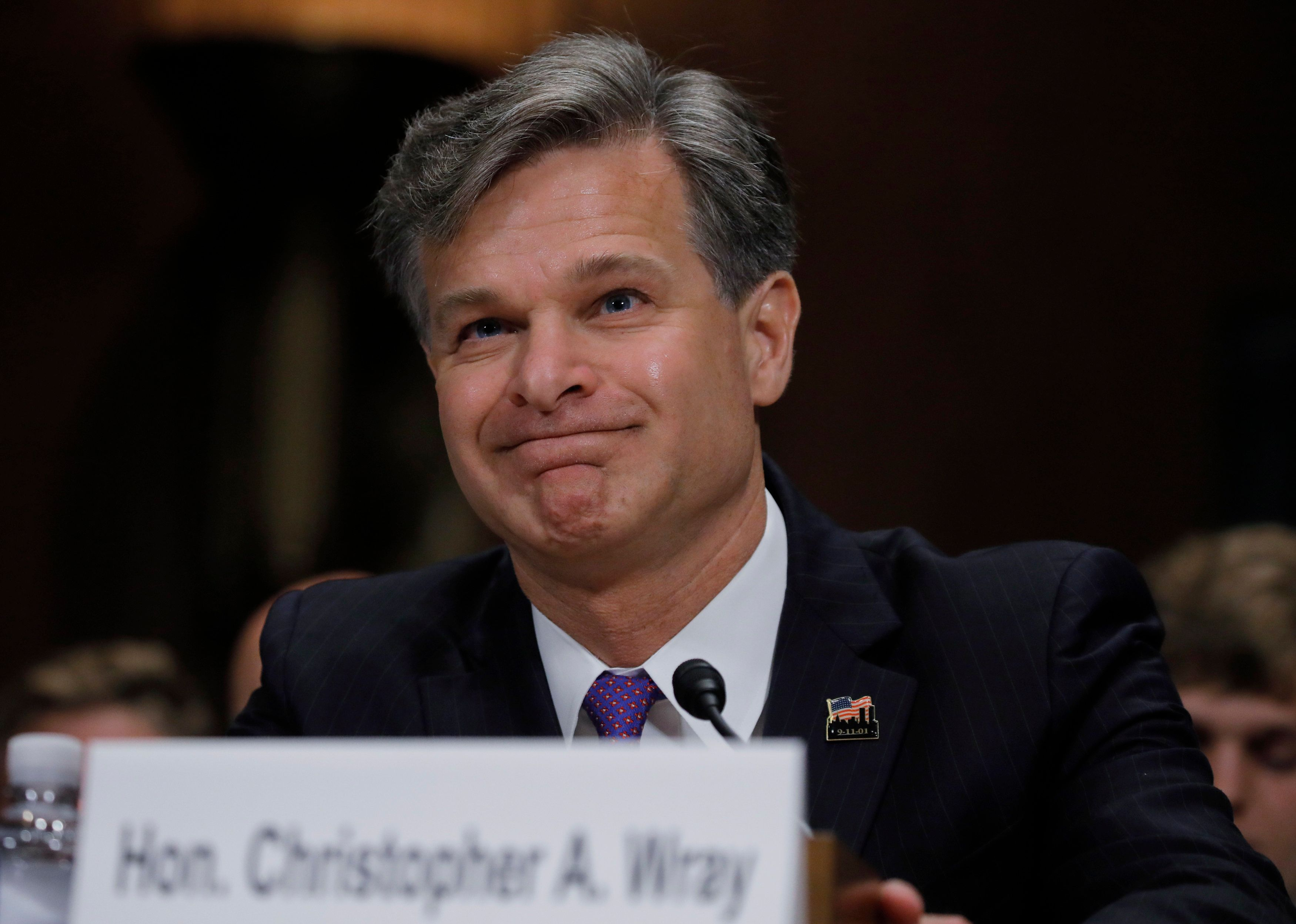 Christopher Wray is seated prior to testifying before a Senate Judiciary Committee confirmation hearing on his nomination to be the next FBI director on Capitol Hill in Washington, U.S., July 12, 2017. REUTERS/Carlos Barria