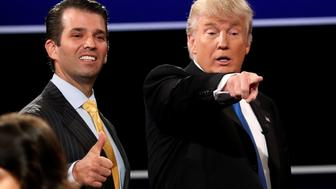 Donald Trump Jr. (L) gives a thumbs up beside his father Republican U.S. presidential nominee Donald Trump (R) after Trump's debate against Democratic nominee Hillary Clinton at Hofstra University in Hempstead, New York, U.S. September 26, 2016.  REUTERS/Mike Segar