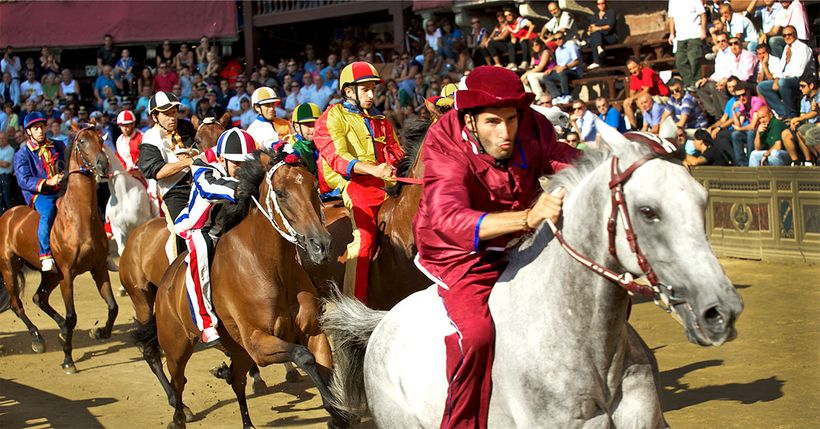 Jockeys race their horses around the difficult to maneuver shell-shaped Piazza del Campo