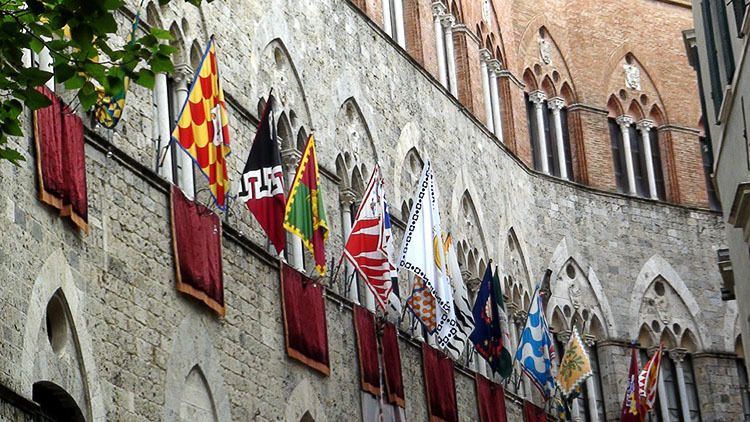 Flags representing the 17 Contrade, or distrcits, of Siena line the streets