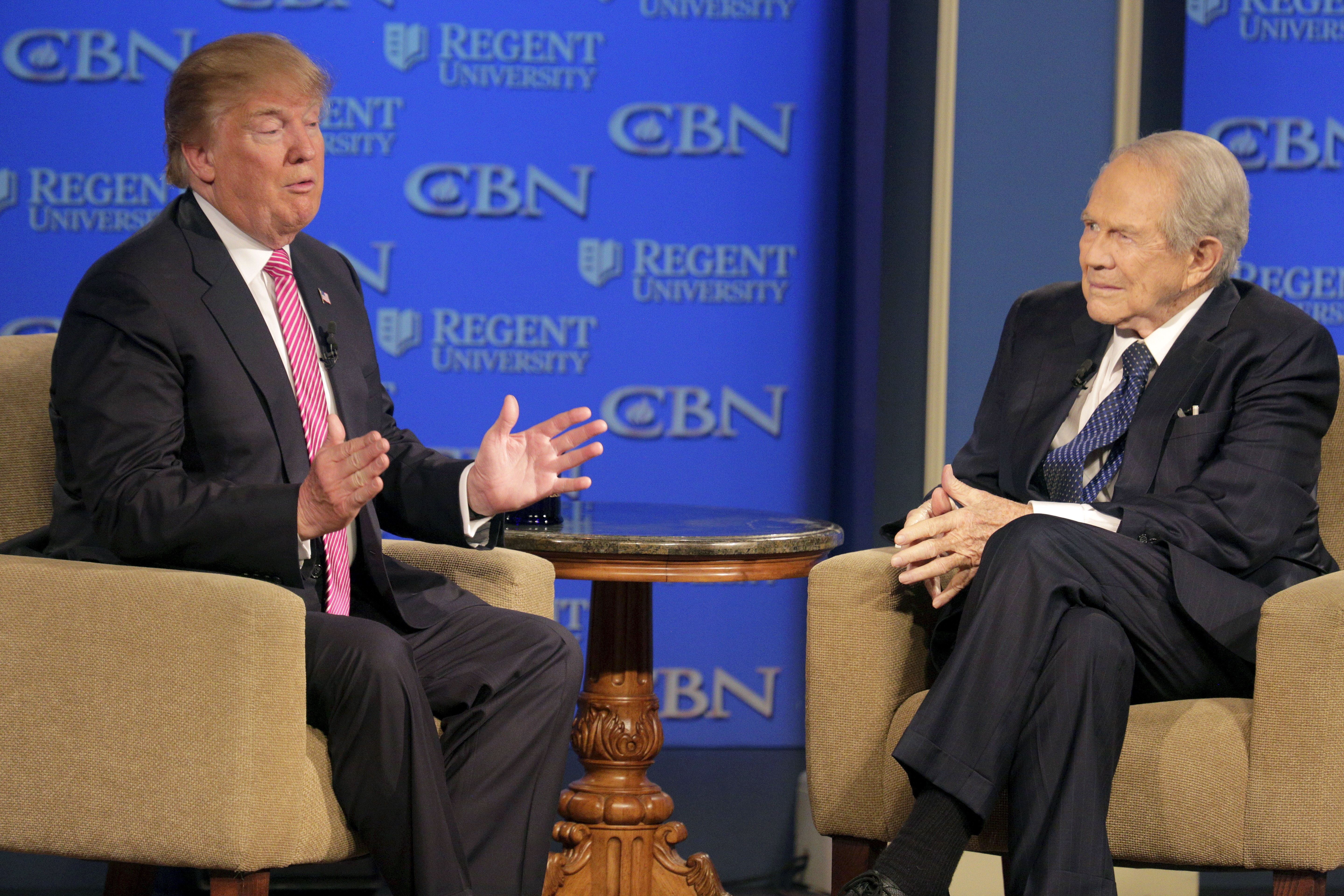 U.S. Republican presidential candidate Donald Trump (L) speaks with Pat Robertson at a campaign event at Regents University in Virginia Beach, Virginia February 24, 2016. REUTERS/Joshua Roberts