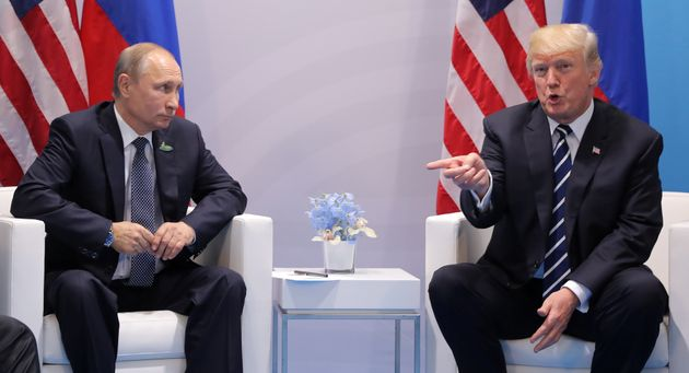 U.S. President Donald Trump, right, said in an interview Wednesday that Russian President Vladimir Putin,...