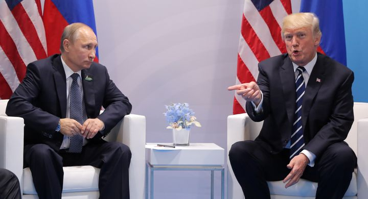 U.S. President Donald Trump, right, said in an interview Wednesday that Russian President Vladimir Putin, left, favored Hilla