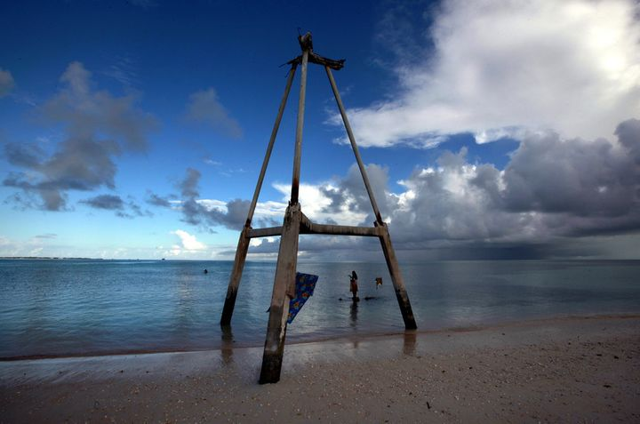 This wood tower on Bikeman islet, in the central Pacific island nation of Kiribati, used to be on the sand. Now it's in the w