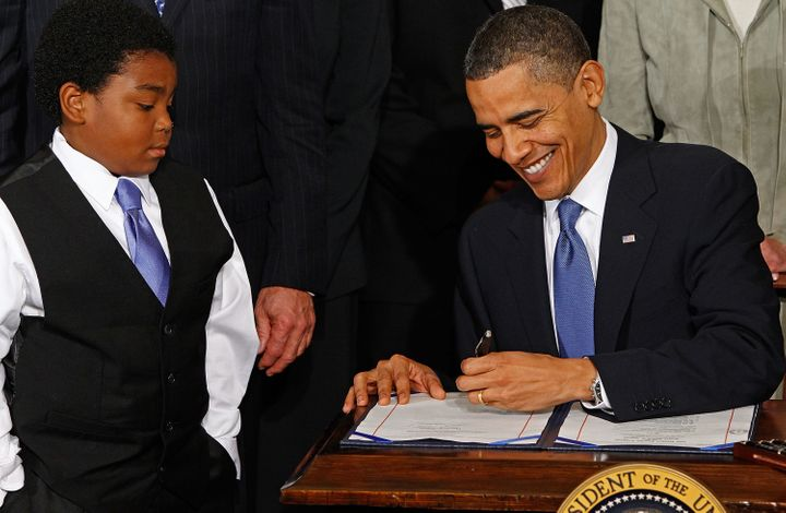 President Barack Obama signs the Affordable Care Act in the East Room of the White House on March 23, 2010.