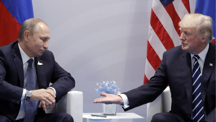 Russia's President Vladimir Putin and President Donald Trump hold a meeting on the sidelines of the G20 summit in Hamburg, Ge