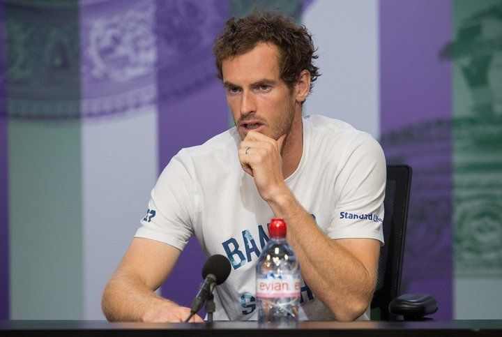Britain's Andy Murray attends a press conference at The All England Tennis Club in Wimbledon, southwest London, on July 12, 2017, after losing his men's quarter-final match against US player Sam Querrey.  Querrey won 3-6, 6-4, 6-7, 6-1, 6-1. / AFP PHOTO / POOL / AELTC AND AELTC/Joe Toth / Joe TOTH        (Photo credit should read JOE TOTH/AFP/Getty Images)