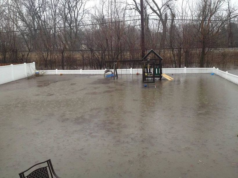 Flooding outside the home of Kendra Scudder Thompson, an Elmhurst, Ill., resident and a member of Stop Elmhurst Flooding.
