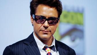 Actor Robert Downey Jr looks out at the crowd  as he leaves a question and answer session following a short  presentation of Iron Man 2  to the the thousands of attendees at this years annual Comic Con conference in San Diego, California July 24, 2009.   REUTERS/Mike Blake   (UNITED STATES ENTERTAINMENT)