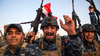 TOPSHOT - Members of the Iraqi federal police forces celebrate in the Old City of Mosul on July 10, 2017 after the government's announcement of the 'liberation' of the embattled city from Islamic State (IS) group fighters. Iraqi Prime Minister Haider al-Abadi's office said he was in 'liberated' Mosul to congratulate 'the heroic fighters and the Iraqi people on the achievement of the major victory'. / AFP PHOTO / Fadel SENNA        (Photo credit should read FADEL SENNA/AFP/Getty Images)