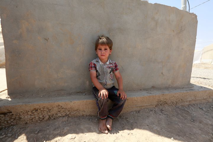 A displaced Iraqi child who fled home is picturedat a camp inIraq onWednesday.