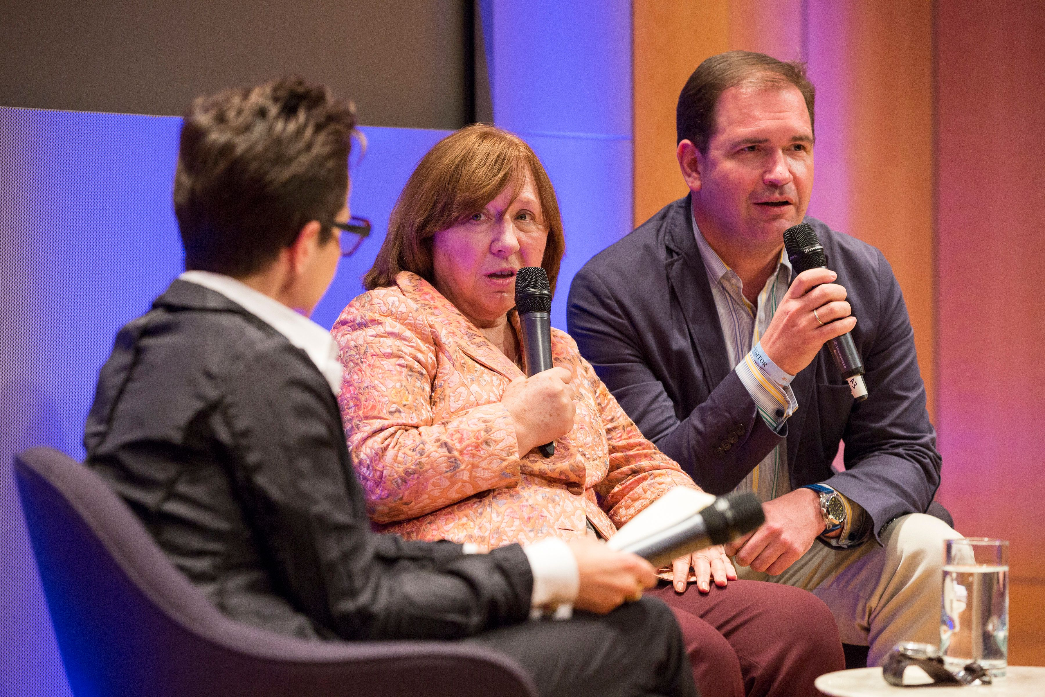 Translator Anatoli Samochornov right  translates at a New York Public Library Event with Masha Gessen and Svetlana Alexievich in 2016