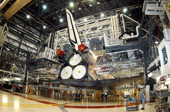 Space Shuttle Atlantis undergoing maintenance at Kennedy Space Center in 2003.