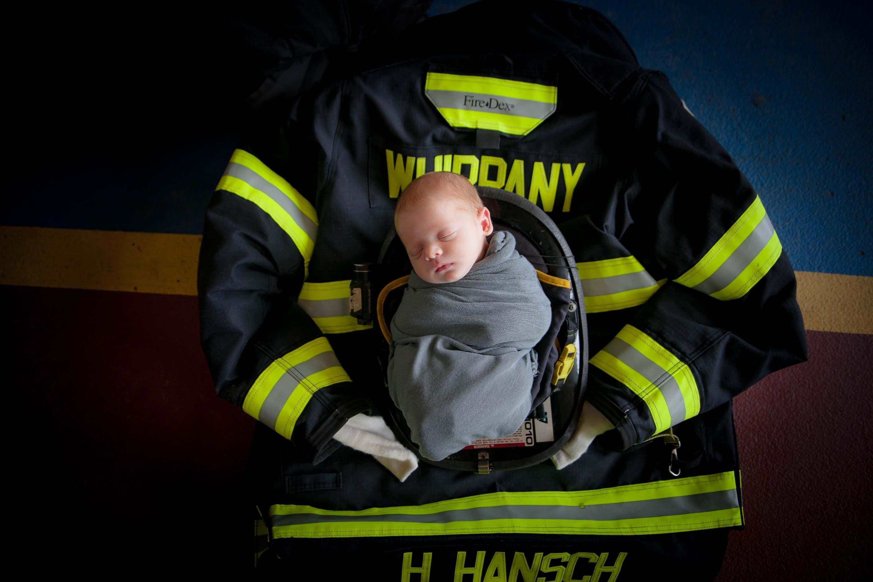 Baby Hudson's newborn photos paid tribute to his firefighter dad.