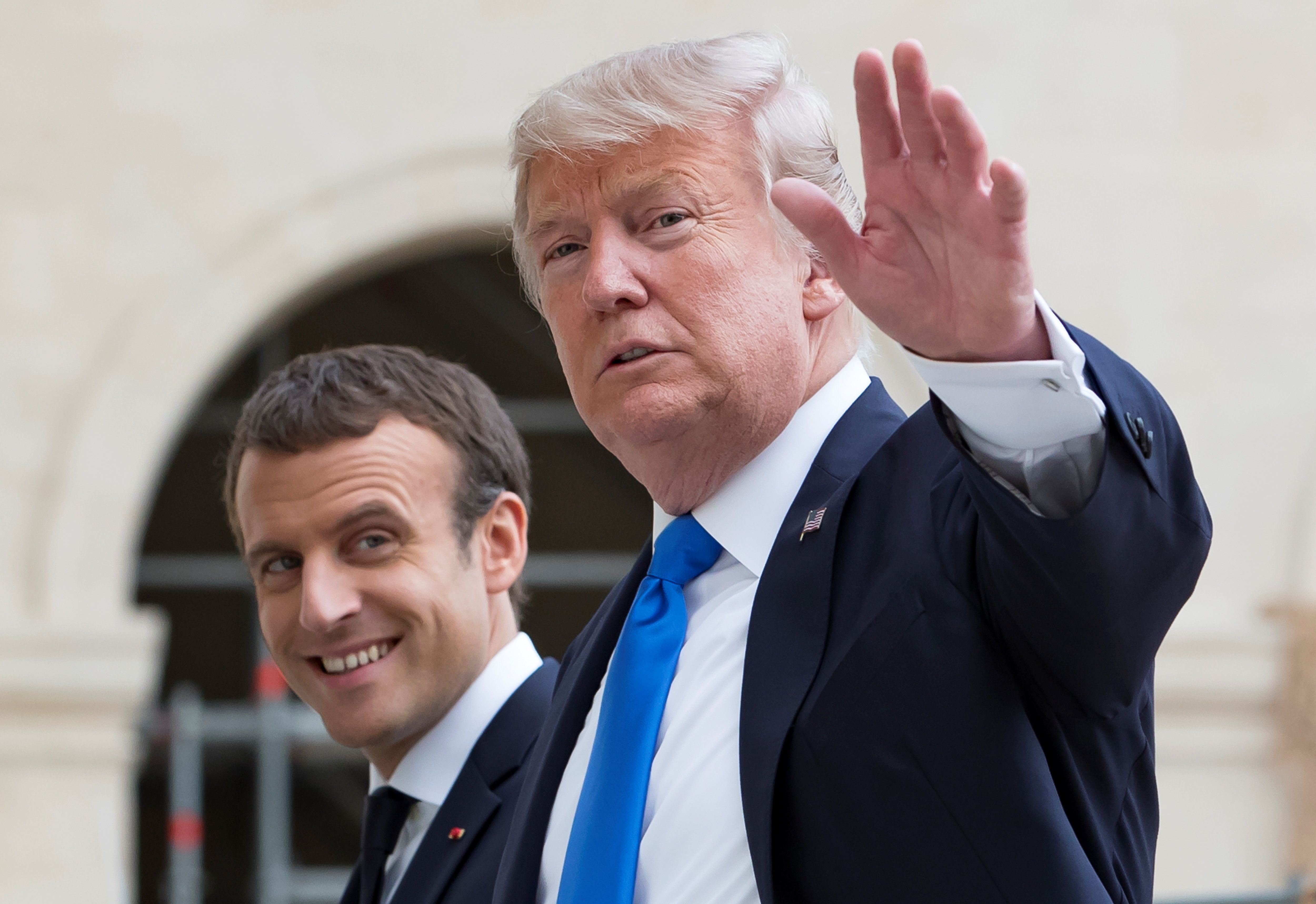 French President Emmanuel Macron (L) and U.S. President Donald Trump (R) speak as they leave Les Invalides museum in Paris, France, July 13, 2017.  REUTERS/Ian Langsdon/Pool