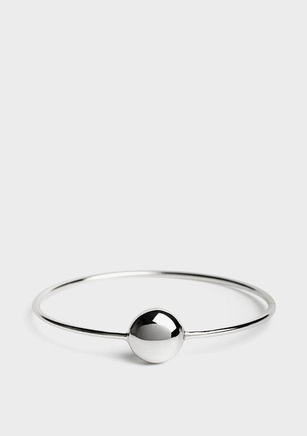 "Get the <a href=""https://www.universalstandard.net/products/pebble-bracelet-silver"" target=""_blank"">Standard Universal pebble"